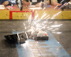 Robots grinding creating sparks
